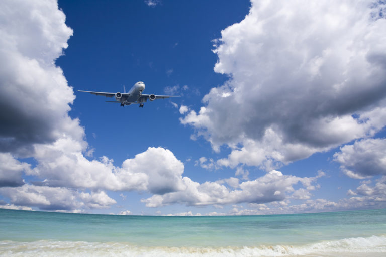 Beautiful sea and sky with airplane .