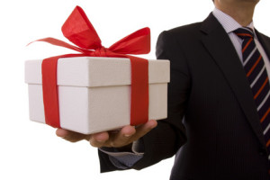 a businessman offering a gift to you (selective focus)-omaggi di beni